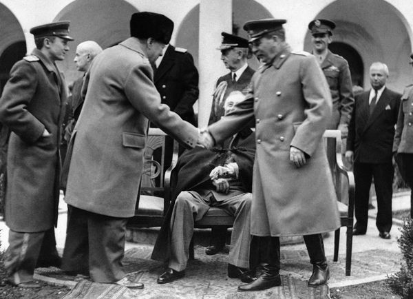 This photo shows Churchill and Stalin mid-hand shake at Livadia Palace in Yalta, Ukraine, on Feb. 13, 1945, but FDR, seated b