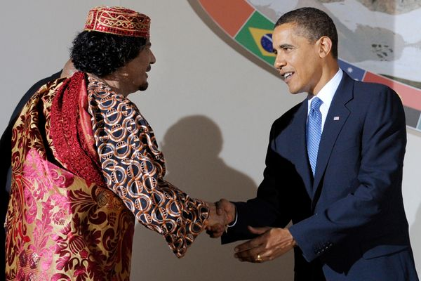 Obama shakes hands with then-Libyan Leader Muammar Gaddafi during the Group of Eight (G8) summit in L'Aquila, central Italy,