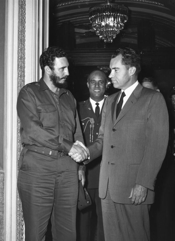 U.S. Vice President Richard Nixon and Cuban Prime Minister Fidel Castro leave Nixon's office April 19, 1959, after a two hour