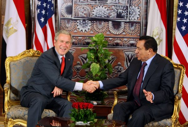 Bush laughs as he shakes hands with then-Egyptian President Hosni Mubarak during a bilateral meeting at the Four Seasons Reso