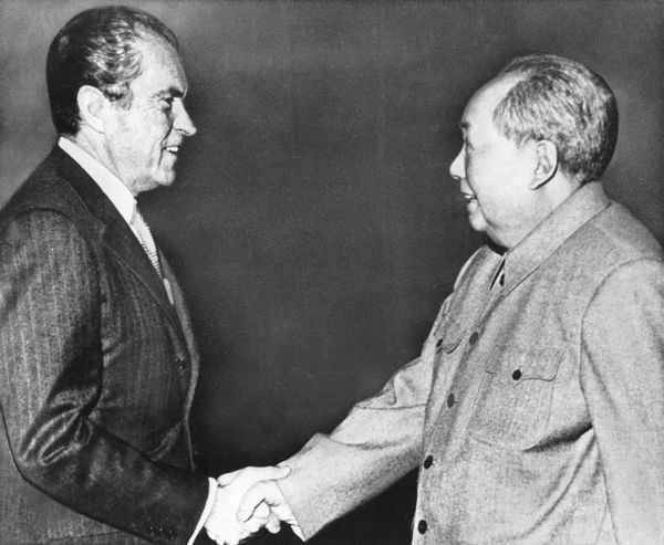 U.S. President Richard Nixon shakes hands with Chinese communist party leader Chairman Mao Tse-Tung, right, during Nixon's gr
