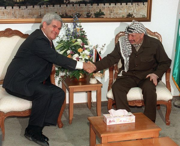 Gingrich, then speaker of the House, shakes hands with then-Palestinian Leader Yasser Arafat at the beginning of a two-hour m