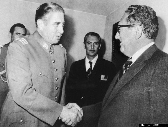Chilean President Augusto Pinochet greets Secretary of State Harry Kissinger on his arrival at the President's office on June