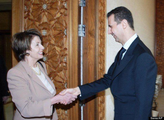 Syrian President Bashar Assad, right, greets then-U.S. House Speaker Nancy Pelosi, in Damascus, on April 4, 2007. Pelosi held