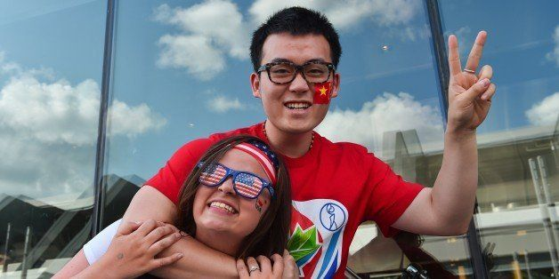 China and USA fans  pose before a 2015 FIFA Women's World Cup quarterfinal match between the USA and China at Lansdowne Stadi