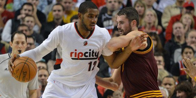 PORTLAND, OR - NOVEMBER 04: LaMarcus Aldridge #12 of the Portland Trail Blazers battles for position with Kevin Love #0 of th