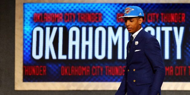 NEW YORK, NY - JUNE 25:  Cameron Payne leaves the stage after being selected 14th overall by the Oklahoma City Thunder in the