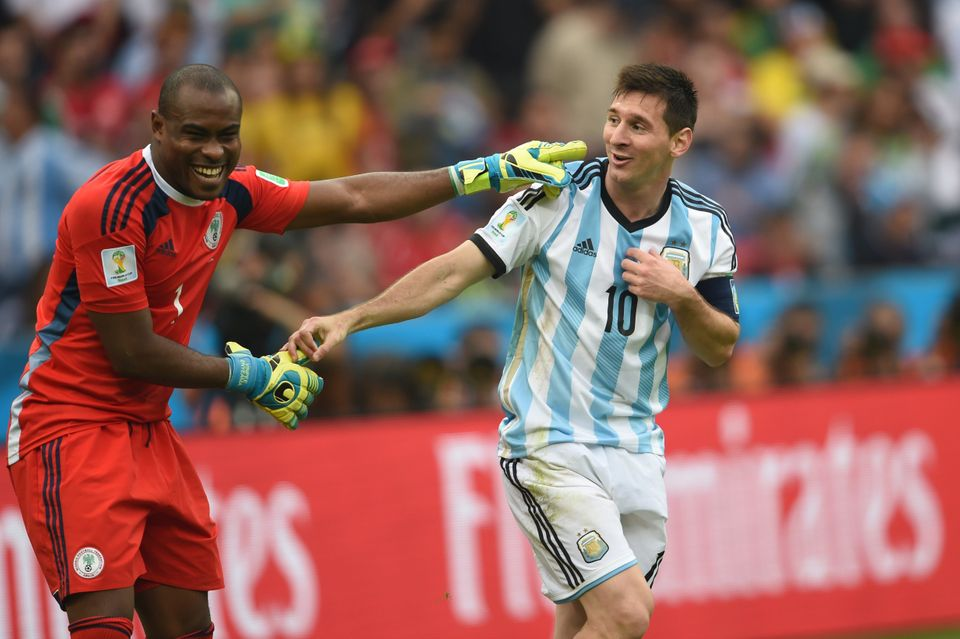 Argentina's forward Lionel Messi (R) and Nigeria's goalkeeper Vincent Enyeama smile during a Group F football match between N
