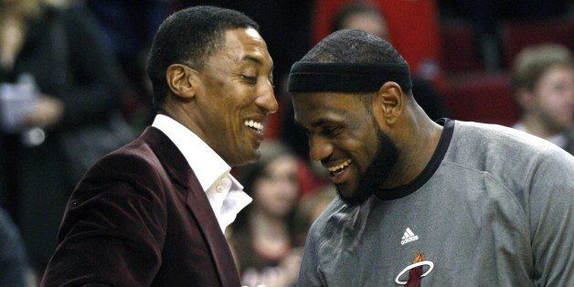 Miami Heat's LeBron James, right, greets former NBA player Scottie Pippen before the start of an NBA basketball game with the