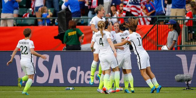 EDMONTON, AB - JUNE 22:  Alex Morgan #13 and Abby Wambach #20 of the United States celebrate after Morgan scores her first go