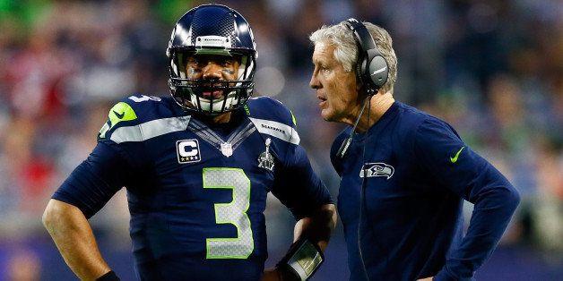 GLENDALE, AZ - FEBRUARY 01:  Head coach Pete Carroll of the Seattle Seahawks talks to Russell Wilson #3 of the Seattle Seahaw