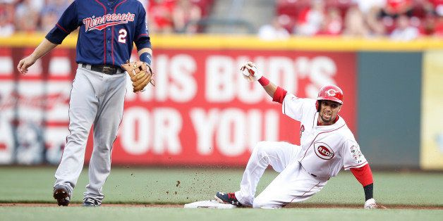 CINCINNATI, OH - JUNE 29: Billy Hamilton #6 of the Cincinnati Reds steals second base in the second inning against the Minnes