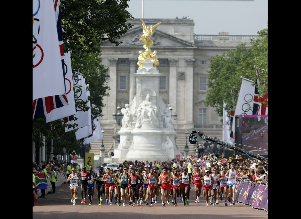 Athletes compete in the men's marathon near the Queen Victoria Memorial and Buckingham Palace at the 2012 Summer Olympics, Su