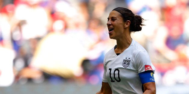 VANCOUVER, BC - JULY 05:  Carli Lloyd #10 of the United States celebrates scoring the opening goal against Japan in the FIFA