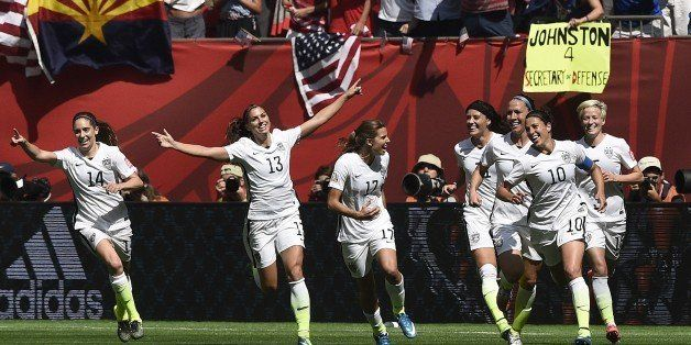 USA midfielder Carli Lloyd (10) celebrates her goal with teammates during the final football match between USA and Japan duri