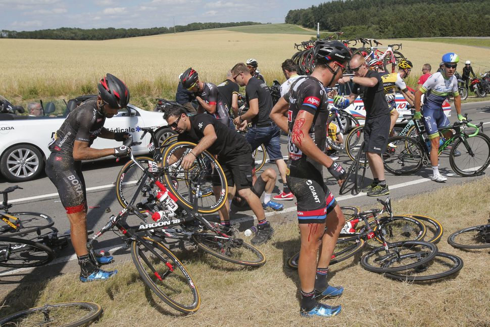 Riders get up after crashing during the third stage of the Tour de France cycling race over 159.5 kilometers (99.1 miles) wit