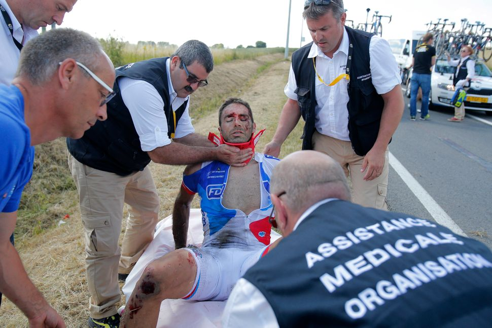 William Bonnet of France is carried onto a stretcher after crashing with several other riders during the third stage of the T