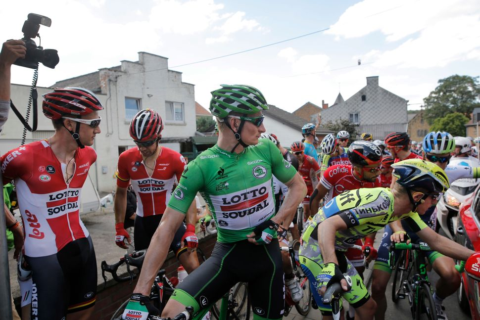 Australia's Michael Rogers, down right corner,  talks to the race direction as Germany's Andre Greipel, wearing the best spri
