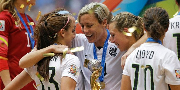 United States' Abby Wambach, center, celebrates with teammates after the U.S. beat Japan 5-2 in the FIFA Women's World Cup so