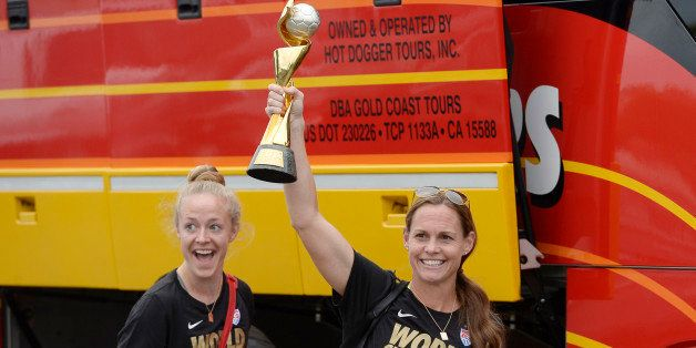 LOS ANGELES, CA - JULY 6: Captain Christie Rampone (R) holds the FIFA Women's World Cup trophy as she walks to the bus with t