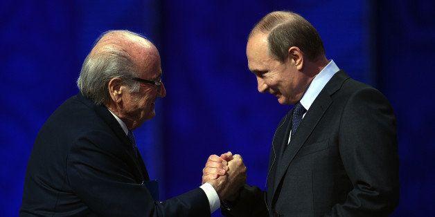 SAINT PETERSBURG, RUSSIA - JULY 25:  FIFA President Joseph S. Blatter shakes hands with Vladimir Putin, President of Russia d