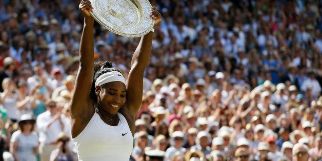 Serena Williams of the United States holds up the trophy after winning the women's singles final against Garbine Muguruza of
