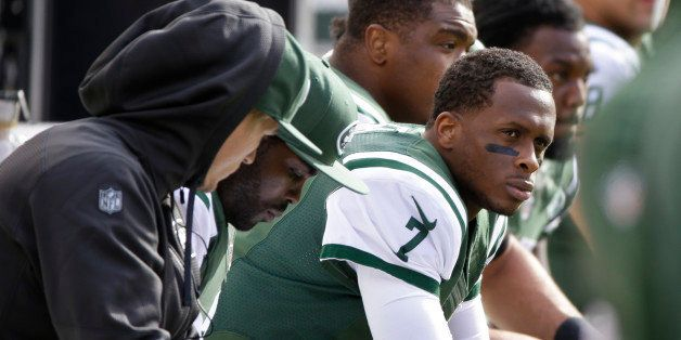 FILE - In this Oct. 26, 2014, file photo, New York Jets quarterback Geno Smith sits on the bench during the first half of an