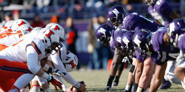 Illinois and Northwestern players line up at the line of scrimmage prior to the snap of the football during a NCAA Football g