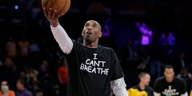 Los Angeles Lakers' Kobe Bryant warms up before an NBA basketball game against the Sacramento Kings, Tuesday, Dec. 9, 2014, i