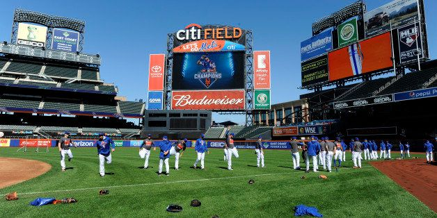 New York Mets players warm up during practice at Citi Field for the NLDS series against the Los Angeles Dodgers, Tuesday, Oct