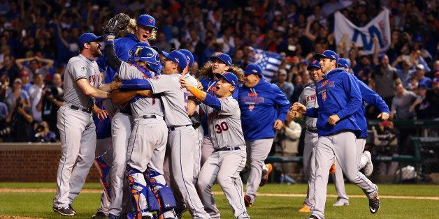 CHICAGO, IL - OCTOBER 21:  The New York Mets celebrate an 8-3 victory in Game 4 of the NLCS against the Chicago Cubs at Wrigl