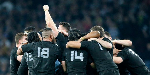 New Zealand players celebrate after winning the Rugby World Cup final between New Zealand and Australia at Twickenham Stadium