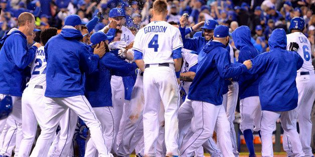 KANSAS CITY, MO - OCTOBER 27:  Members of the Kansas City Royals celebrate defeating the New York Mets in Game 1 of the 2015