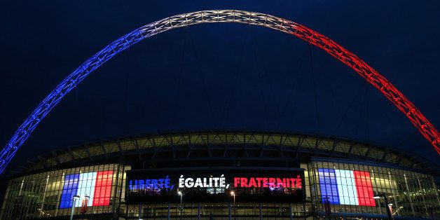 LONDON, ENGLAND - NOVEMBER 16:  Wembley stadium is lit up in the French Tricolore in remembrance to the victims of last weeks