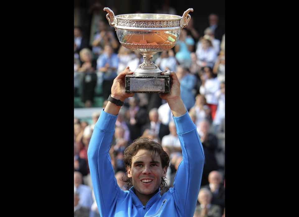 Spain's Rafael Nadal holds the cup after defeating Switzerland's Roger Federer in the men's final match for the French Open t