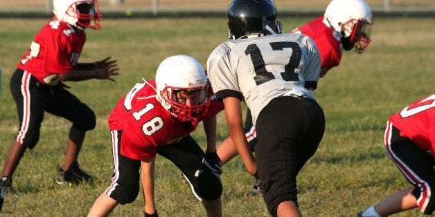 youth football player in a...