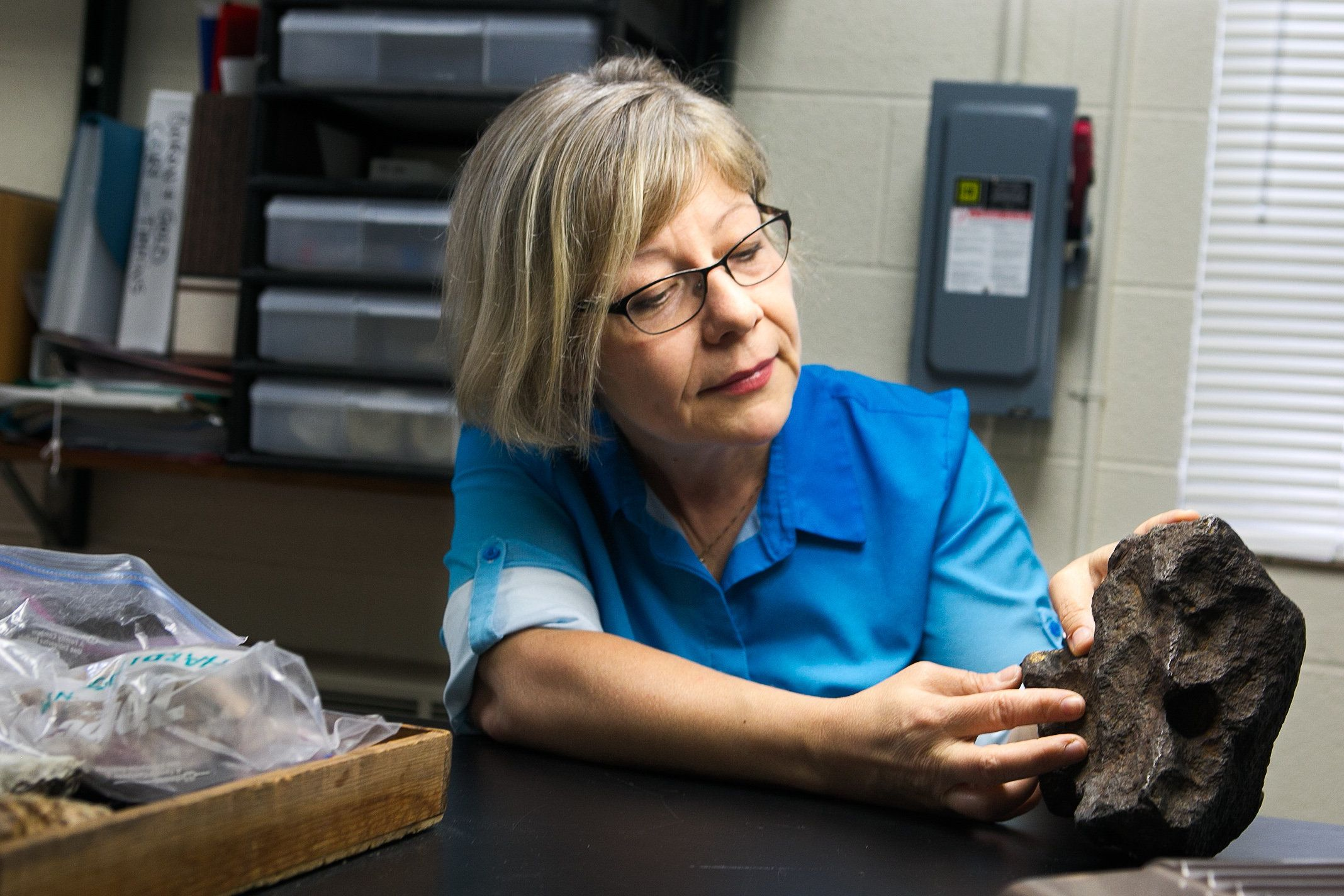 Central Michigan University Photo/ Professor Monaliza Sirbescu shows off a meteorite.