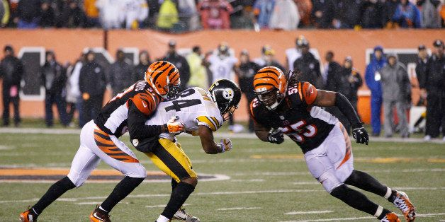 CINCINNATI, OH - JANUARY 9: Vontaze Burfict #55 of the Cincinnati Bengals makes a late hit on Antonio Brown #84 of the Pittsb