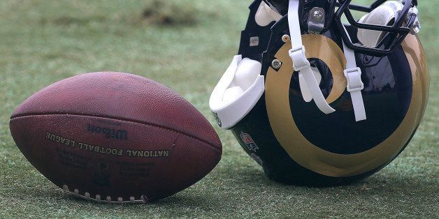 OXNARD, CALIF. -- MONDAY, AUGUST 17, 2015: Detail shot of gloves used by St. Louis Rams running back Todd Gurley during the D