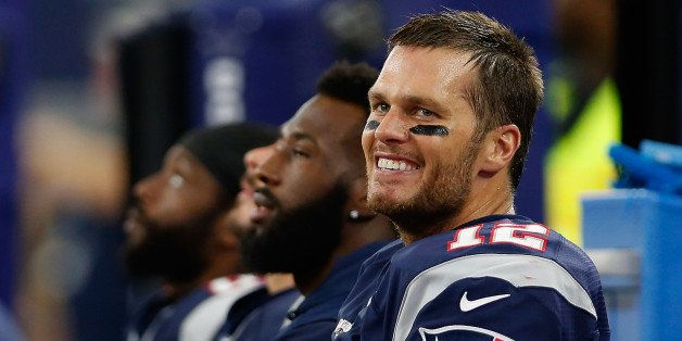 ARLINGTON, TX - OCTOBER 11:  Quarterback Tom Brady #12 of the New England Patriots on the sidelines during the second half of