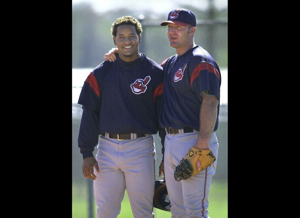 WINTER HAVEN, UNITED STATES:  Cleveland Indians' outfielder Manny Ramirez of the Dominican Republic (L) talks with Indians' f