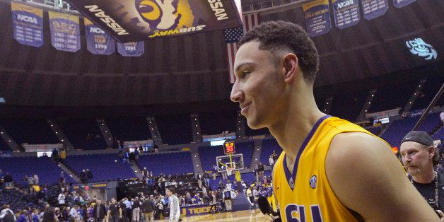 LSU forward Ben Simmons, of Australia,  smiles while leaving the court after LSU defeated Kentucky 85-67 in an NCAA college b