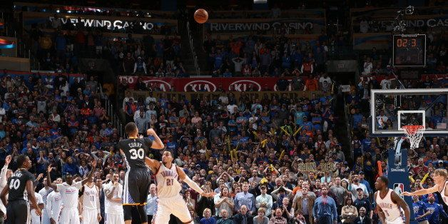 OKLAHOMA CITY, OK - FEBRUARY 27:  Stephen Curry #30 of the Golden State Warriors hits the winning shot against Andre Roberson