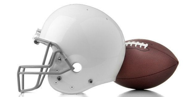 Football helmet and ball on white background.  Please see my portfolio for other football and sport images.