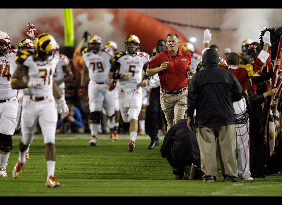 COLLEGE PARK, MD - SEPTEMBER 05: Head coach Randy Edsall of Maryland Terrapins runs onto the field before the start of the Te