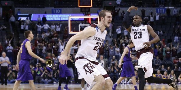 Texas A&M guard Alex Caruso, left, and guard Danuel House (23) celebrate as Northern Iowa players walk off the court afte