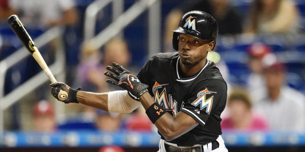 MIAMI, FL - AUGUST 22:  Dee Gordon #9 of the Miami Marlins bats during a MLB game against the Philadelphia Phillies at Marlin