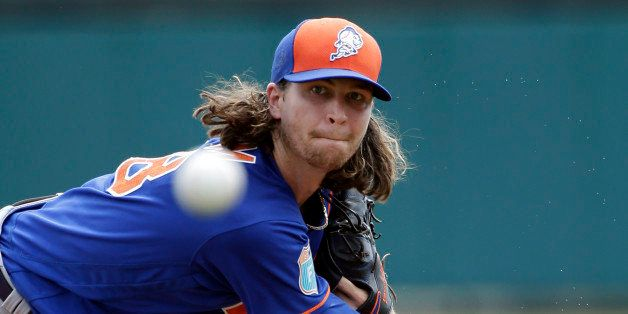New York Mets starting pitcher Jacob deGrom throws against the Atlanta Braves in the first inning of a spring training baseba