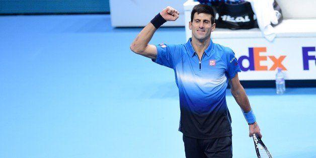 Serbia's Novak Djokovic celebrates after winning the men's singles final match against Switzerland's Roger Federer on day eig