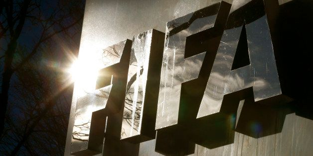 The sun is reflected in FIFA's logo in front of FIFA's headquarters in Zurich, Switzerland November 19, 2015. The head of the
